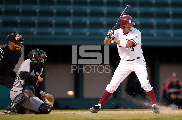 STANFORD, CA - April 12, 2011: Kenny Diekroeger of Stanford baseball watches ball four in the dirt during Stanford's game against Pacific at Sunken Diamond. The ball got past the catcher moving Zach Jones to third. Stanford won 3-1.