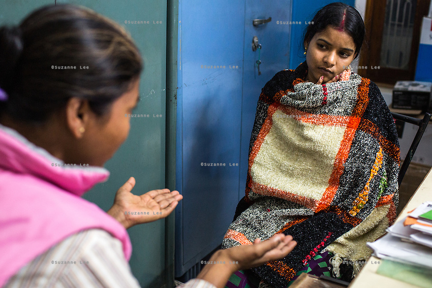 Brinda (right) is counselled by Santwana Manju in between legal team sessions during the preparation for her final witness court appearance in the Guria office in Varanasi, Uttar Pradesh, India on 22 November 2013. She is one of the 57 underaged and trafficked girls rescued from the Shivdaspur red light area in Varanasi, who has been fighting a court case against her traffickers and brothel owners for the past 8 years.