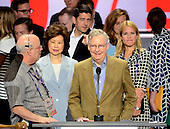 United States Senate Majority Leader Mitch McConnell (Republican of Kentucky) and his wife, Elaine Chao participate in a rehearsal prior to the 2016 Republican National Convention in Cleveland, Ohio on Sunday, July 17, 2016.  Standing behind them and pointing is US Speaker of the House Paul Ryan (Republican of Wisconsin) and his wife Janna.<br /> Credit: Ron Sachs / CNP<br /> (RESTRICTION: NO New York or New Jersey Newspapers or newspapers within a 75 mile radius of New York City)