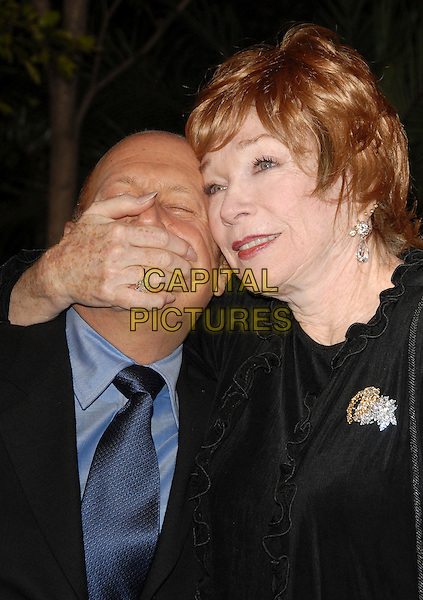 """SHIRLIE MacLAINE & GUEST.Arrivals at the Paramount Pictures' Premiere of """"Dreamgirls"""" held at The Wilshire Theatre, Beverly Hills, California, USA, December 11th 2006..portrait headshot shirley Mclaine hand over mouth funny.CAP/DVS.©Debbie VanStory/Capital Pictures"""