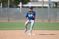 Los Angeles Dodgers second baseman Sam McWilliams (9) waits to receive a throw during an Instructional League game against the Milwaukee Brewers at Maryvale Baseball Park on September 24, 2018 in Phoenix, Arizona. (Zachary Lucy/Four Seam Images)
