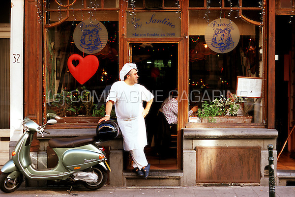 "a cook standing outside his Italian restaurant ""Chez Santino"" in the rue Duquesnoy, Brussels (Belgium, 13/10/2006)"