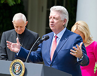 "Pastor Jack Graham offers a prayer prior to United States President Donald J. Trump signing a Proclamation designating May 4, 2017 as a National Day of Prayer and an Executive Order ""Promoting Free Speech and Religious Liberty"" in the Rose Garden of the White House in Washington, DC on Thursday, May 4, 2017. Photo Credit: Ron Sachs/CNP/AdMedia"