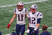 3rd February 2019, Atlanta Georgia, USA; NFL Superbowl LIII, New England Patriots versus Los Angeles Rams; New England Patriots quarterback Tom Brady (12) and New England Patriots wide receiver Julian Edelman (11) come to the sideline in the fourth quarter of Super Bowl LIII