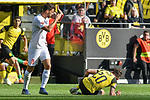 06.10.2018, Signal Iduna Park, Dortmund, GER, DFL, BL, Borussia Dortmund vs FC Augsburg, DFL regulations prohibit any use of photographs as image sequences and/or quasi-video<br /> <br /> im Bild Rani Khedira (#8, FC Augsburg) gestikuliert Maximilian Philipp (#20, Borussia Dortmund) am Boden<br /> <br /> Foto &copy; nph/Horst Mauelshagen