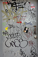 Metal door covered in urban grafitti, Vancouver, BC, Canada