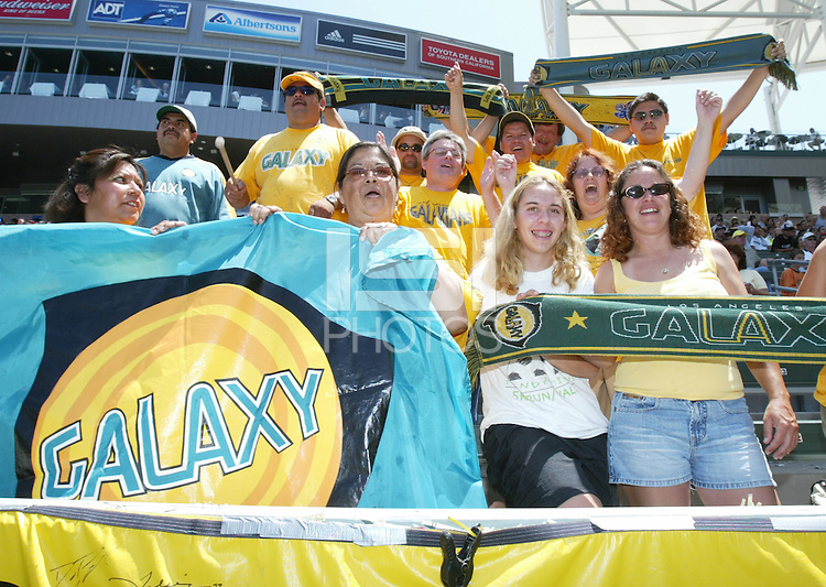 12 June 2004: Galaxy fans celebrates Galaxy's goal against Chicago Fire at Home Depot Center in Los Angeles, California.    Los Angeles defeated Chicago Fire, 3-2.  Mandatory Credit: Michael Pimentel / ISI