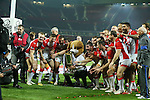St Helens celebrate with the trophy at the end- First Utility Super League Grand Final - St Helens v Wigan Warriors - Old Trafford Stadium - Manchester - England - 11th October 2014 - Pic Paul Currie/Sportimage