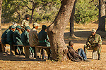 Arrested poacher being questioned by anti-poaching commander, Kafue National Park, Zambia