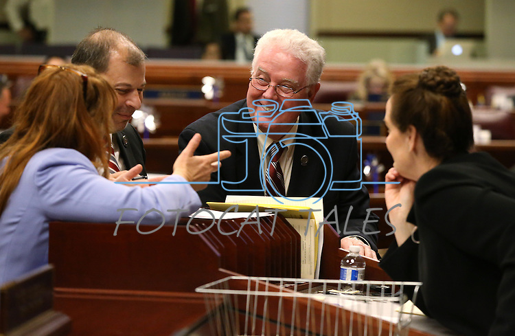 From left, Nevada Assembly Minority Leader Marilyn Kirkpatrick, D-North Las Vegas, Majority Leader Paul Anderson, R-Las Vegas, and Assembly Speaker John Hambrick, R-Las Vegas, talk to Chief Clerk Susan Furlong on the Assembly floor at the Legislative Building in Carson City, Nev., on Monday, April 6, 2015. <br /> Photo by Cathleen Allison