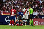 Atletico de Madrid's Thomas Lemar (l), Diego Costa (c) and Rayo Vallecano's Abdoulaye Ba have words with referee Xavier Estrada Fernandez during La Liga match. August 25, 2018. (ALTERPHOTOS/A. Perez Meca)