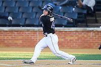 Mark Lumpa (4) of the Duke Blue Devils follows through on his swing against the Wake Forest Demon Deacons at Wake Forest Baseball Park on April 25, 2014 in Winston-Salem, North Carolina.  The Blue Devils defeated the Demon Deacons 5-2.  (Brian Westerholt/Four Seam Images)