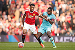 Anthony Martial of Manchester United battles West Ham's Michail Antonio during the Emirates FA Cup match at Old Trafford. Photo credit should read: Philip Oldham/Sportimage
