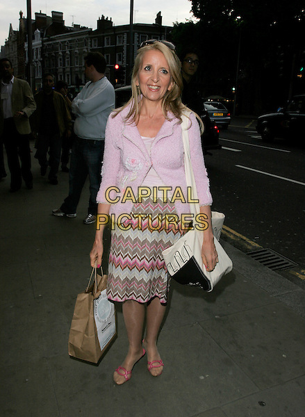 GILLIAN McKEITH.Attends the launch party for the opening of Whole Foods Market Kensington, High Street Kensington, London, England, June 4th 2007..full length pink jacket patterned zigzag skirt paper bag.CAP/AH.©Adam Houghton/Capital Pictures.