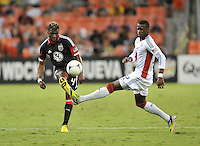 D.C. United defender Brandon McDonald (4) goes against New England Revolution forward Dimitry Imbongo (92) D.C. United defeated The New England Revolution 2-1 at RFK Stadium, Saturday September 15, 2012.