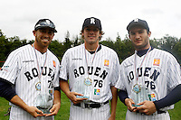 17 July 2011: Jordan Crystal of the Rouen Huskies poses with the MVP trophy next to Owen Ozanich, winner of the Best Pitcher award and Joris Bert, best batter, after the 2011Challenge de France final match won 6-4 by the Rouen Huskies over the Savigny Lions, at Stade Pierre Rolland, in Rouen, France.