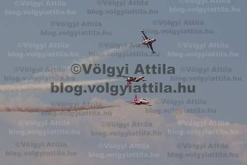 F-5 aircrafts of the Turkish Stars squadron from the Turkish Airforce perform during the International Air Show at the Hungarian Air Force base in Kecskemet (about 87 km South-East of the capital city Budapest), Hungary on August 03, 2013. ATTILA VOLGYI