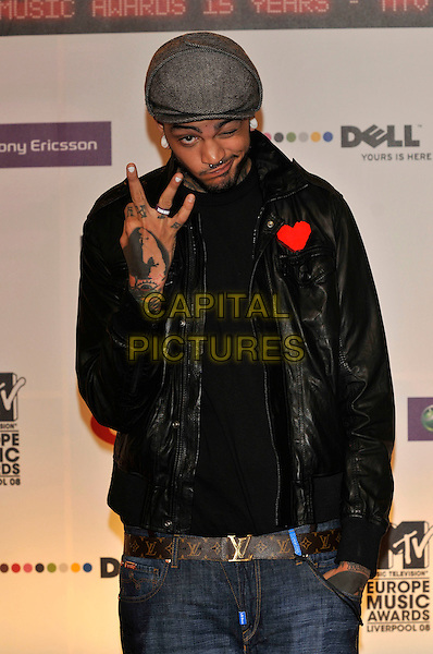 TRAVIS McCOY - GYM CLASS HEROES.2008 MTV Europe Music Awards arrivals at Echo Arena, Liverpool, England..6th November 2008.EMA half length black leather jacket tattoos grey gray hat hand.CAP/PL.©Phil Loftus/Capital Pictures.