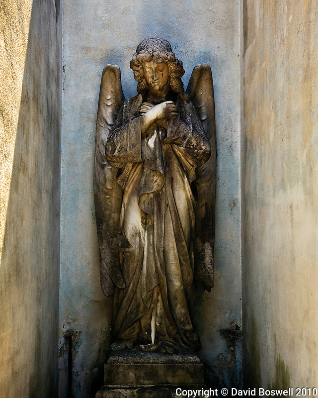 An angelis sculpture decorates a tomb in the Cementario de la Recoleta in Buenos Aires.
