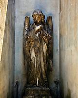 An angelis sculpture decorates a tomb in the Cementario de la Recoleta in Buenos Aires.