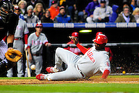 April 11, 2009: Phillies 1st baseman and 2009 National League Most Valuable Player candidate Ryan Howard slides into home ahead of the throw to Rockies catcher Yorvit Torrealba during a game between the Philadelphia Phillies and the Colorado Rockies at Coors Field in Denver, Colorado. The Phillies beat the Rockies 8-4.