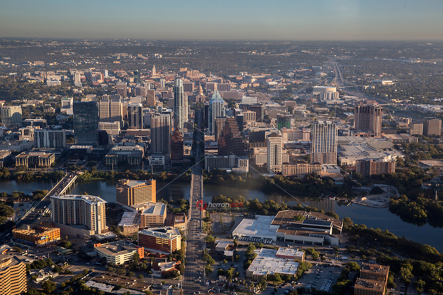 Aerial view looking north of the Austin Skyline from a helicopter looking up Congress Avenue from South Austin to the Texas State Capitol. University of Texas campus and UT Tower can be seen in the foreground.