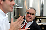 Alain Ducasse (R) and chef Jerome Lacressonniere talk in the kitchen of Beige Alain Ducasse Tokyo in the Ginza district of Tokyo, Japan on June 3 2008. ..Photographer: Robert Gilhooly..