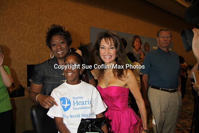 Susan Lucci with Shamos who is getting a new hearing aid at the Starkey Hearing Foundation event on June 18, 2011 at the Las Vegas Hilton, Las Vegas, Nevada. The event was able to give out 100 hearing aids. (Photo by Sue Coflin/Max Photos)