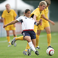 10 July 2005: Lorrie Fair of USA kicks the ball away from Ukraine defender during the second half of the game at Merlo Field at University of Portland in Portland, Oregon.    USA defeated Ukraine, 7-0.   Credit: Michael Pimentel / ISI