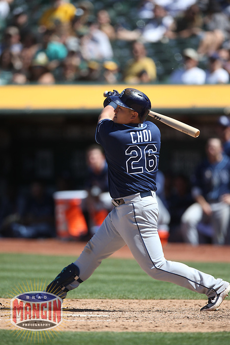OAKLAND, CA - JUNE 22:  Ji-Man Choi #26 of the Tampa Bay Rays hits a home run against the Oakland Athletics during the game at the Oakland Coliseum on Saturday, June 22, 2019 in Oakland, California. (Photo by Brad Mangin)