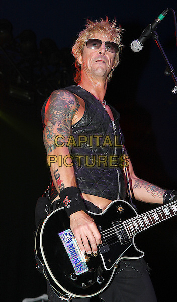 LOADED - Duff McKagan .Download Festival 2009 - Day One Donington Park, Derbyshire, England. .June 12th, 2009.stage concert live gig performing performance music half length black waistcoat tattoos sunglasses shades guitar.CAP/MAR.© Martin Harris/Capital Pictures.