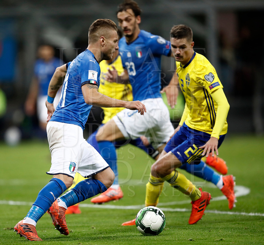 Soccer Football - 2018 World Cup Qualifications - Europe - Italy vs Sweden - San Siro, Milan, Italy - November 13, 2017 <br /> Italy's Ciro Immobile (l) in action with Sweden's Mikael Lustig (r) during the FIFA World Cup 2018 qualification football match between Italy and Sweden at the San Siro Stadium in Milan on November 13, 2017.<br /> UPDATE IMAGES PRESS/Isabella Bonotto