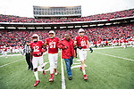 Wisconsin Badgers honorary captain Ron Dayne with captains Natrell Jamerson (12), Alec James (57) and Troy Fumagalli (81) during an NCAA College Big Ten Conference football game against the Iowa Hawkeyes Saturday, November 11, 2017, in Madison, Wis. The Badgers won 38-14. (Photo by David Stluka)