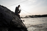 Oct. 10, 2016 - Don Sahong, Laos. A fisherman pulls his nets from the Mekong River near the Lipi waterfalls. © Nicolas Axelrod / Ruom