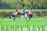 Dara O'Shea Killorglin skips past two Fethard defenders to score his first senior try for Killorglin on Sunday