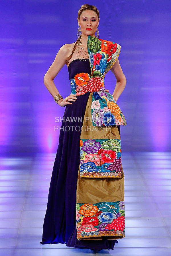 Model walks runway in an outfit from the hmo by Harumi Momota collection, during Couture Fashion Week Spring 2014, on September 7, 2013.