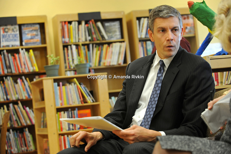 """Arne Duncan, the Chief Executive Officer of the Chicago Public Schools, CPS, talks with a woman before a press conference for Chicago Mayor Richard M. Daley's """"Principal for a Day"""" program of corporate sponsorship and volunteerism in the Chicago Public Schools at Talcott Elementary School at 1840 W. Ohio St. in Chicago, Illinois on October 17, 2008."""