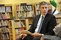 "Arne Duncan, the Chief Executive Officer of the Chicago Public Schools, CPS, talks with a woman before a press conference for Chicago Mayor Richard M. Daley's ""Principal for a Day"" program of corporate sponsorship and volunteerism in the Chicago Public Schools at Talcott Elementary School at 1840 W. Ohio St. in Chicago, Illinois on October 17, 2008."