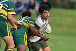 Manurewa flanker V. Roight gets taken by S. Lutumailaqi. Counties Manukau Premier Club Rugby, Pukekohe v Manurewa  played at the Colin Lawrie field, on the 17th of April 2006. Manurewa won 20 - 18.
