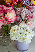 Close up of various bunches of roses, freshly cut to decorate a table