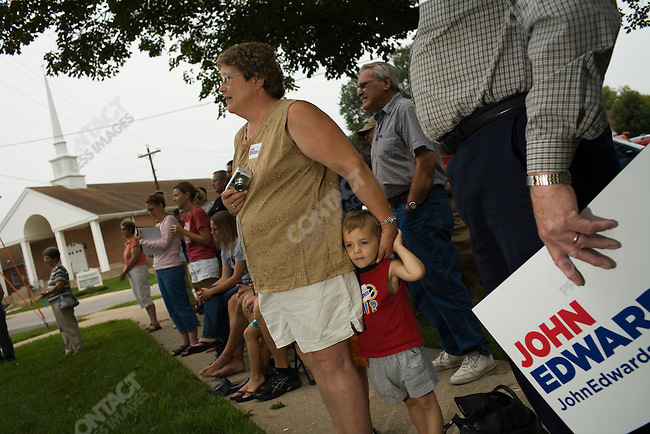 Supporters of former Senator John Edwards (D-North Carolina), potential Democratic presidential candidate, watch as he campaigns outside of the Grundy County Courthouse. Grundy Center, Iowa, August 16, 2007.