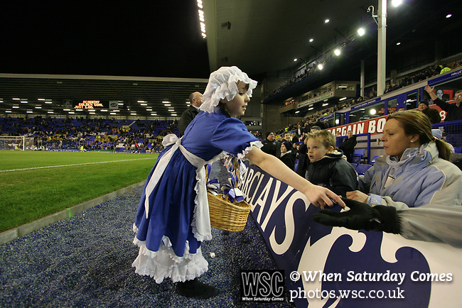 Everton 1, West Ham United 2, 14/12/2005. Goodison Park, FA Premiership. A child mascot hands out toffees to fans inside the stadium before Everton host West Ham United in a mid-season game on Merseyside. The away team came from behind to win, watched by a crowd of 35,704. Photo by Colin McPherson.