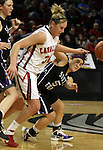 03/11/11--Clackamas' Jen Reese battles for a loose ball with South Eugene's Olivia Roberts  in the semifinals of the 6A girls state championship at the Rose Garden in Portland, Or. The Cavaliers advanced to the championship with a score of 46-35...Photo by Jaime Valdez......................................