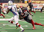 SIOUX FALLS, SD - JUNE 7 James Dunlap #16 from the Sioux Falls Storm tries to chase down quarterback Jerell Norton #3 from the Texas Revolution in the second quarter of their game Saturday night at the Sioux Falls Arena. (Photo by Dave Eggen/Inertia)