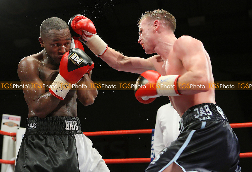 Ian Napa (Hackney, black/white shorts) defeats Martin Power (Camden Town, dark blue shorts) for the British Bantamweight Title at Newham Leisure Centre, promoted by Frank Maloney - 30/11/07 - MANDATORY CREDIT: Gavin Ellis/TGSPHOTO. Self-Billing applies where appropriate. NO UNPAID USE. Tel: 0845 094 6026