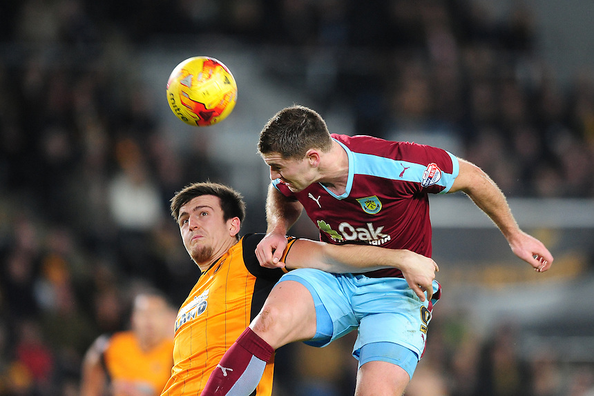Burnley's Sam Vokes vies for possession with Hull City's Harry Maguire<br /> <br /> Photographer Chris Vaughan/CameraSport<br /> <br /> Football - The Football League Sky Bet Championship - Hull City v Burnley - Saturday 26th December 2015 - Kingston Communications Stadium - Hull<br /> <br /> &copy; CameraSport - 43 Linden Ave. Countesthorpe. Leicester. England. LE8 5PG - Tel: +44 (0) 116 277 4147 - admin@camerasport.com - www.camerasport.com