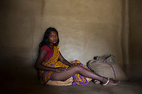 """India - Jharkhand - Dhab - """"That day I went to mine at 9, together with my parents. When I started digging, the walls were so soft that they collapsed upon me. I fainted immediately"""" A beautiful mother of four kids, four months ago 25-year-old Sarita Devi fractured her right leg when the mine she was working subsized, completely burying her. Today, she still cannot walk properly, bend or crouch. Unable to help her family in the mine, she stays at home, looking after her sons and elder relatives. Although she doesn't like the idea of going back to the mine, Sarita will have to, once she will completely recover from the accident in one-year-time. The eldest of two brotherless sisters, it's Sarita who will have to look after her aging parents and find a way to repay the 100,000 rupees loan the family took to pay for her hospital expenses."""
