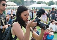 "Documentary film maker, Fozia Nasir, at ""Showtime"", part of the London 2012 Festival of Arts to celebrate the London Olympics.  A family fun spectacle including dance, painting, music, acrobatics and some large mobile dynosaurs walking amongst the crowd.  On Blackheath Common, Saturday August 4th and funded by the Mayor of London and Arts Council England."