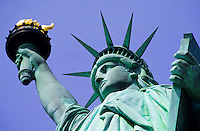 Statue of Liberty head and arm from a low angle