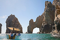 Tourists ride a boat at Land End at Cabo San Lucas, Baja California, Mexico